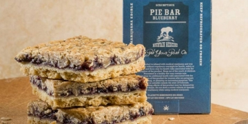 mountain medicine blueberry pie bar on cutting board